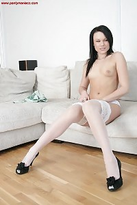 Naughty Brunette Strips In Her Tight Black Leotard Before Slipping Down To Just Her Hold Up Nylons.