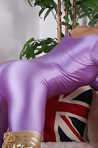Blonde Danna Flaunts Off Her Purple Satin Outfit On The Couch