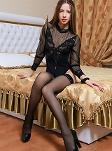 Blue-eyed darling Mika A with long brown hair, long and slim figure, and saucy breasts