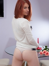 Redhead Paige demonstrates off her soft, young body with pink pussy as she poses for her debut series.